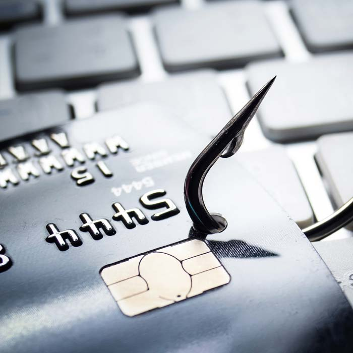 Fish Hook Through A Credit Card On A Laptop