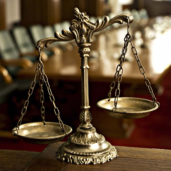 Brass Scales Of Justice In Court Room