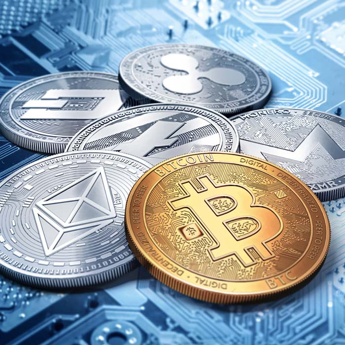 Cryptocurrency Coins On Computer Chip Background
