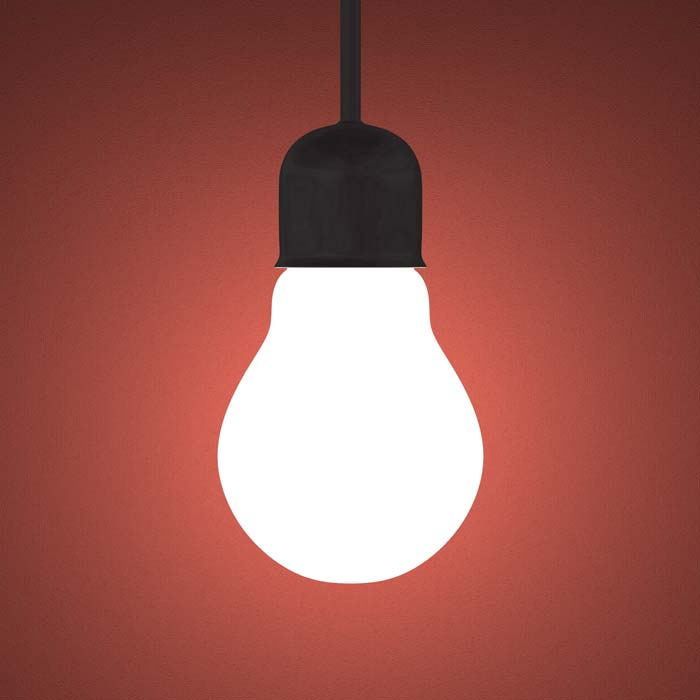 Lit Lightbulb On Dark Red-orange Background